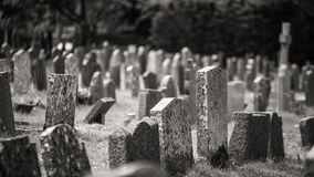 Monochrome graveyard with old headstones giving eerie feel stock photos