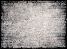 Monochrome grunge background with brick frame. Stock Photo