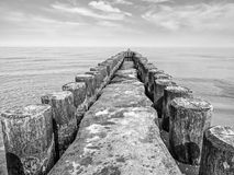 Monochrome image of the Baltic Sea with breakwaters Royalty Free Stock Photos