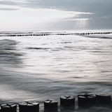 Monochrome image of the Baltic Sea with breakwaters at sunset Stock Photography
