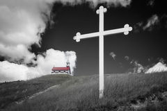 Monochrome image of church with red roof with steeple. Royalty Free Stock Image