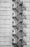 Monochrome image of the exterior of a building. Monochrome image of the exterior of a building with old fire escape Royalty Free Stock Images