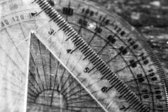 Monochrome image, mathematical rulers on aged weathered pine wood boards