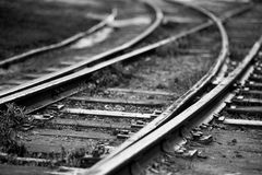 Monochrome image of old railroad track splitting Royalty Free Stock Images