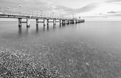 Monochrome image of the pier. Royalty Free Stock Photo