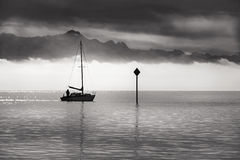 Monochrome image of a single boat sailing Stock Photo
