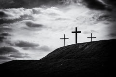 Monochrome image of three crosses sitting on a hill Stock Photo