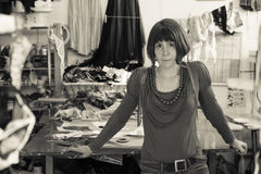 Monochrome Image of Woman in a Tailoring Shop Stock Images