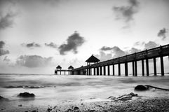 Monochrome low tide at jetty Stock Photography