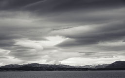 Monochrome Norwegian coastal landscape, dark sky Royalty Free Stock Images