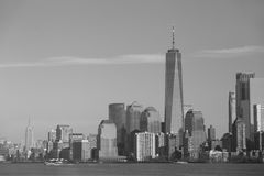 NY monochrome - One World Trade Centre and Empire State. Monochrome of NY City skyline as seen on the Ellis Island ferry including the One World Trade Center Stock Image