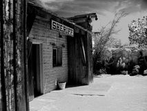 Monochrome old west Sheriff's building. Monochrome old western Sheriff's office with desert landscape Stock Photography