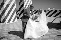 Monochrome photo of bride and groom dancing on roof top Royalty Free Stock Image