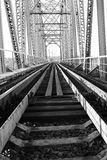 Monochrome photo of the bridge on the railroad tracks and indust Royalty Free Stock Photos