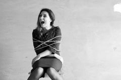 Monochrome photo of a business woman sitting on chair associated Royalty Free Stock Image