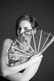 Monochrome photo of the girl with a fan Stock Image