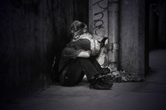 Monochrome Photo of a Homeless Man Royalty Free Stock Image