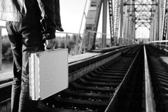 Monochrome photo of silver metal case with money transfer concep Stock Photography