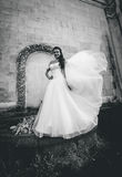 Monochrome photo of wind lifting up brides veil at old castle Royalty Free Stock Photos