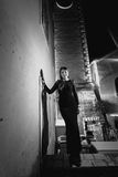 Monochrome photo of woman in evening dress standing on street at Stock Photography