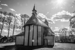 Monochrome photo of wooden church in summer day Stock Photo
