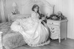Monochrome photo young aristocrat sitting Royalty Free Stock Photos