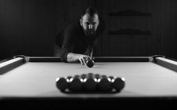 Monochrome photo young man playing billiards Stock Photo