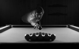 Monochrome photo young man playing billiards Stock Photos