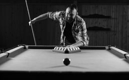 Monochrome photo young man playing billiards Stock Image