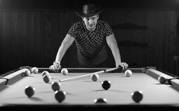 Monochrome photo young man playing billiards royalty free stock photo