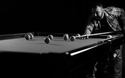 Monochrome photo young man playing billiards. Monochrome photo of young man playing billiards stock photos