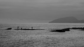 Monochrome photography Fishermen on the pier Royalty Free Stock Photo