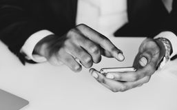 Monochrome Photography of a Person Using Mobile Phone Royalty Free Stock Photo