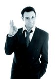 Monochrome picture of friendly businessman showing ok sign Stock Photos