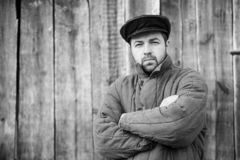 Monochrome portrait of bearded men in old-fashioned clothes, caucasian man 35 years old royalty free stock photography