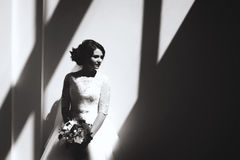 Monochrome portrait of beautiful bride with bouquet Royalty Free Stock Photo