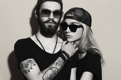 Monochrome portrait of beautiful couple together. Tattoo Hipster boy and gir. Fashion monochrome portrait of beautiful couple together. Tattoo Hipster boy and stock image