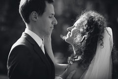 Monochrome  portrait of bride and groom looking at each other Royalty Free Stock Photography