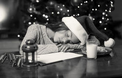 Monochrome portrait of cute girl fell asleep while writing lette Stock Photo