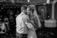 Monochrome portrait of dancing at restaurant bride and groom Stock Photos