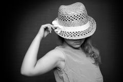 Monochrome portrait of girl with straw hat Royalty Free Stock Image