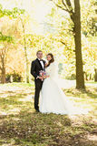 Monochrome portrait of happy bride and groom kissing at alcove Stock Photo