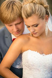 Monochrome portrait of happy bride and groom kissing at alcove Stock Image