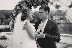 Monochrome portrait of happy bride and groom looking at each oth Royalty Free Stock Photo