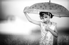 monochrome portrait of happy little girl with umbrella Royalty Free Stock Photo