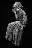 Monochrome portrait of praying woman Royalty Free Stock Image