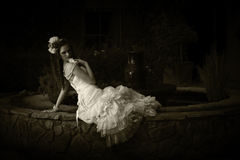 Monochrome portrait of vintage bride next to fountain Royalty Free Stock Images