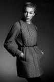 Monochrome portrait of woman in coat Stock Image