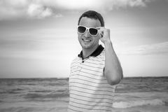Monochrome portrait of young smiling Caucasian man Royalty Free Stock Photography