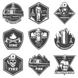 Monochrome Professional Firefighting Labels Set. With fireman truck and rescue equipment in vintage style isolated vector illustration Royalty Free Stock Photos